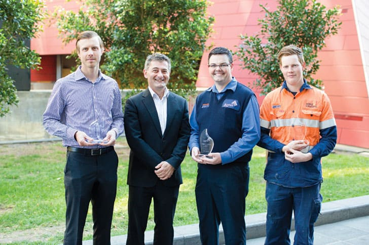 AUSNET SERVICES' 2014 APPRENTICES AND TRAINEES OF THE YEAR. GENERAL MANAGER - SERVICE DELIVERY, JOHN AZARIS (SECOND FROM LEFT) WITH (FROM LEFT TO RIGHT) – MITCH WUOTI, ROBERT MONK, AND JAMES BURT.
