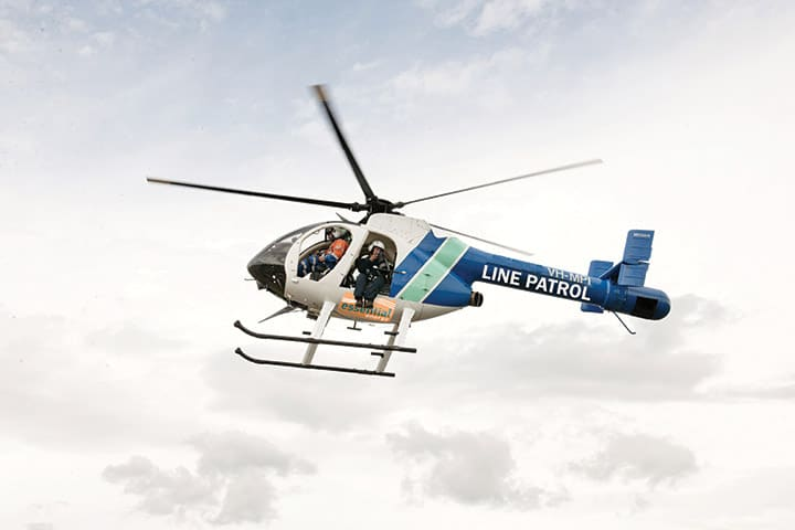 An aerial patrol helicopter using LiDAR technology to scan essential energy's electricity network.