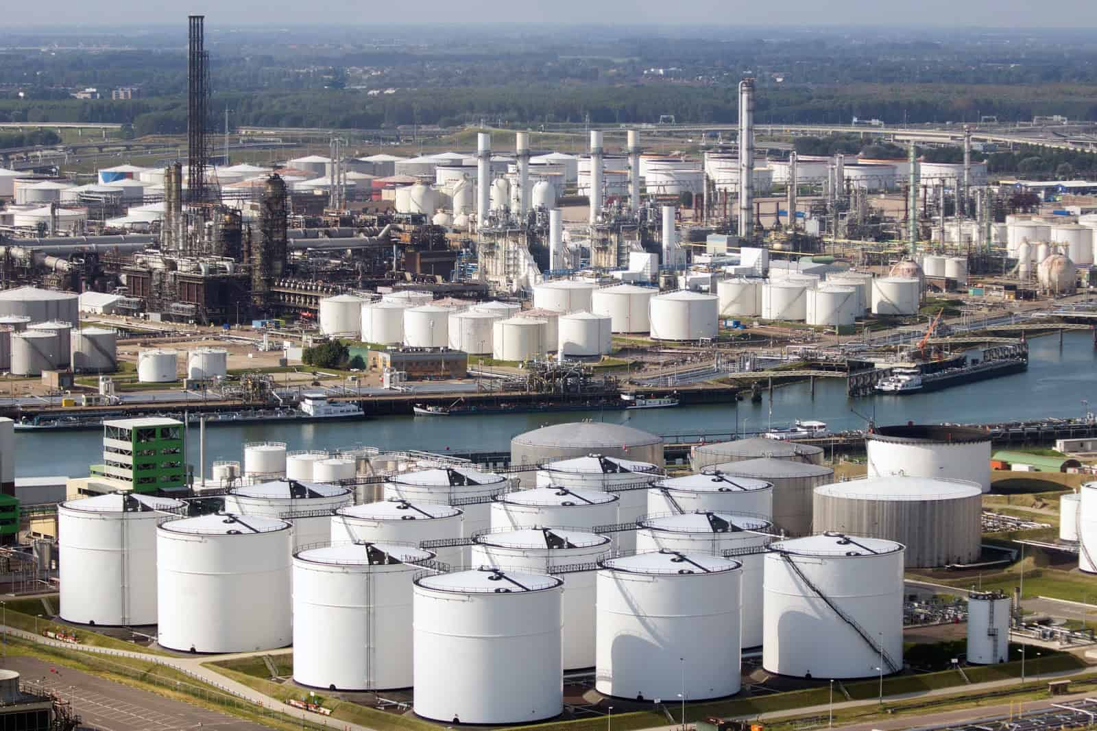 ROTTERDAM - SEP 8, 2012: Oil storage tanks on in the Port of Rotterdam. The port is the largest in Europe and facilitate the needs of a hinterland with 40,000,000 consumers.